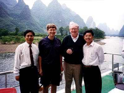 Bill Gates and Warren Buffet travel with us