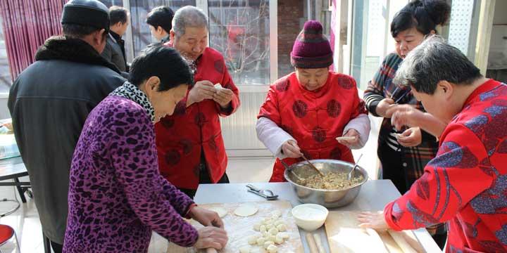 Family making dumpling together